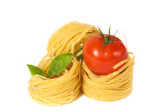 Tomato, macaroni and green basil Royalty Free Stock Photos