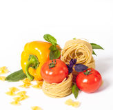 Tomato, macaroni red and green basil Royalty Free Stock Photos