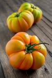 Tomato marmande on wooden table Royalty Free Stock Photos