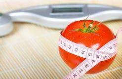 Tomato with measure Royalty Free Stock Photos
