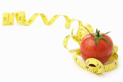 Tomato with measuring tape Stock Photo