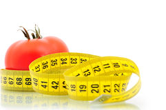 Tomato and measuring tape. Diet concept Royalty Free Stock Image