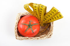 Tomato with a measuring tape Royalty Free Stock Photo