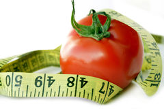Tomato with measuring tape Royalty Free Stock Photos