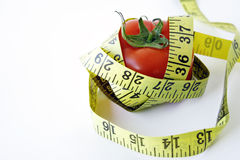 Tomato with measuring tape royalty free stock images