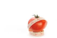 Tomato with meter Stock Photo