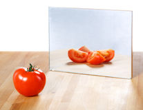 Tomato in mirror image. Abstract vision Stock Image