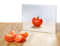 Tomato in mirror image Stock Photos