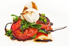 Tomato, mozarella & rocket salad Stock Image