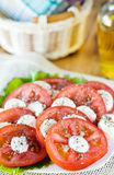 Tomato and mozarella salad. On the white plate Royalty Free Stock Photography