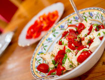 Tomato and Mozarella- salad Stock Photos