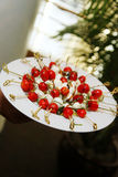 Tomato Mozzarella Appetizers. Plate of grape or cherry tomatoes and mozzarella cheese appetizers on skewers Stock Images