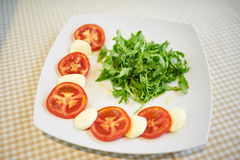 Tomato With Mozzarella With Arugula Royalty Free Stock Image