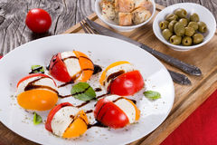 Tomato. mozzarella, basil caprese summer salad, close-up royalty free stock photography
