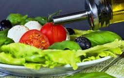 Caprese salad. Classic caprese salad. Italian traditional caprese salad ingredients. Mediterranean food. Stock Image