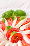 Tomato with mozzarella cheese Stock Photos