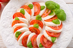 Tomato with mozzarella cheese Royalty Free Stock Photography