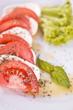 Tomato and mozzarella cheese with green basil and salad Stock Photography