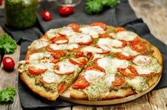 Tomato mozzarella kale pesto pizza Stock Image