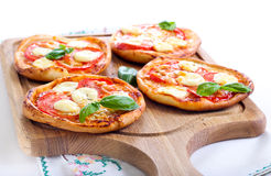 Tomato and mozzarella mini pizzas Stock Photos