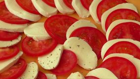 Tomato and mozzarella on a plate stock video footage
