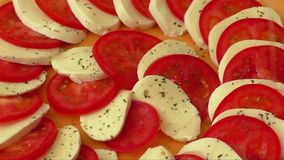 Tomato and mozzarella stock footage