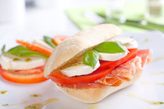 Tomato and Mozzarella Sandwich. With fresh basil leaves Stock Photo