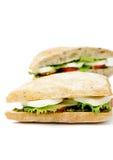 Tomato Mozzarella Sandwich. Fresh sandwich with mozzarella, tomatoes and pesto, isolated on white Royalty Free Stock Images