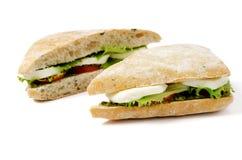 Tomato Mozzarella Sandwich. Sandwich with mozzarella, tomatoes and pesto, isolated Royalty Free Stock Images