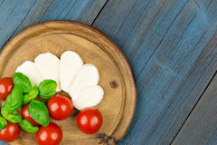 Tomato mozzarella slice basil Stock Image