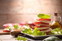 Caprese salad on rustic table royalty free stock photos