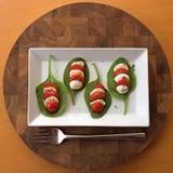 Tomato, mozzarella & spinach salad Stock Images
