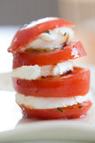 Tomato mozzarella. View of an Italian specialty starter with tomato and mozzarella, side view stock image