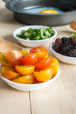 Tomato, mulberry side dish ingredient and fried egg in pan Stock Photos