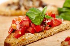 Tomato and mushroom bruschettas Stock Image