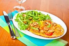 Tomato and mushroom omelette. Stock Photo