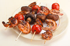 Tomato, mushroom and prawn kebabs Royalty Free Stock Photo