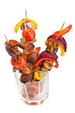 Tomato, mushrooms and king prawn kebabs Stock Images