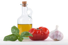Tomato, olive oil, basil and garlic Royalty Free Stock Images