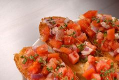 Tomato and onion bruschetta wi Stock Image
