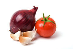 Tomato onion and garlic. A photo of fresh garlic, onion and tomato Royalty Free Stock Image