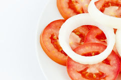 Tomato and onions. Close up view of some sliced tomato and onions on a isolated white background royalty free stock photo