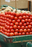 Tomato over two wheel car in traditional market royalty free stock photography