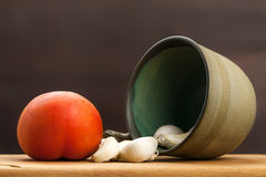 Tomato and overturned rustic bowl with garlic Royalty Free Stock Image
