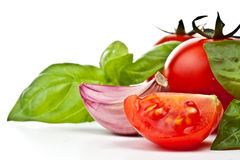 Tomato of Pachino , basil and garlic Royalty Free Stock Photos