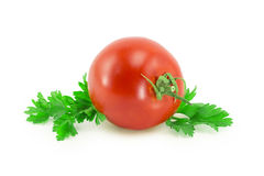 Tomato, parsley Royalty Free Stock Image