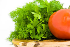 Tomato with parsley. Succulent tomato with parsley for salad royalty free stock image