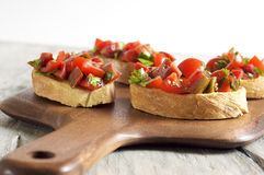 Tomato and parsley bruschetta Stock Photos