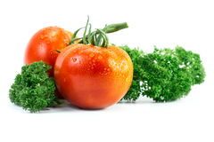 Tomato and parsley with drop Royalty Free Stock Photo