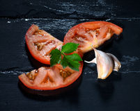 Tomato with Parsley and Garlic Cloves. Healthy and Organic Foods Stock Photo